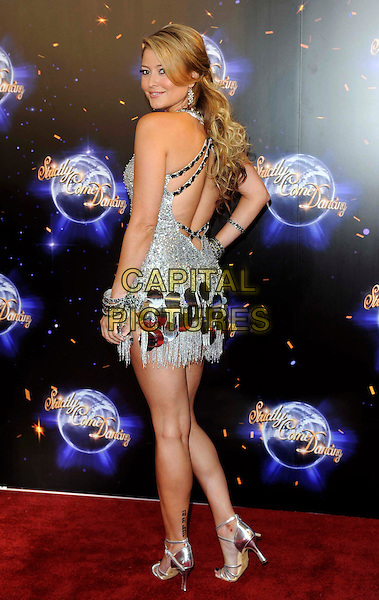 Holly Valance.'Strictly Come Dancing' Launch Event at BBC Studios, London, England..September 7th 2011.full length silver dress  white tassels fringed looking over shoulder back behind rear sequins sequined studs studded .CAP/FIN.©Steve Finn/Capital Pictures.