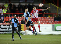 Matthew Bloomfield of Wycombe Wanderers defends against Accrington Stanley billy kee<br /> during the Sky Bet League 2 match between Accrington Stanley and Wycombe Wanderers at the Wham Stadium, Accrington, England on 16 March 2016. Photo by Tony (KIPAX) Greenwood / PRiME Media Images.