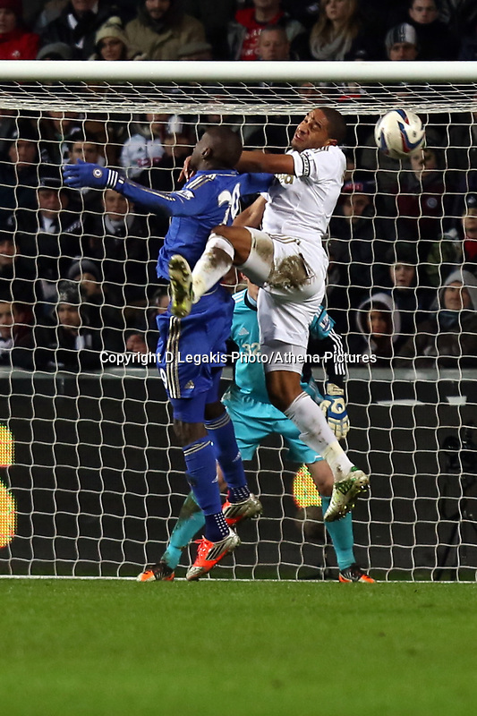 Wednesday 23 January 2013<br /> Pictured: (L-R) Demba Ba of Chelsea and Ashley Williams of Swansea.<br /> Re: Capital One Cup semi-final second leg, Swansea City FC v Chelsea at the Liberty Stadium, south Wales.