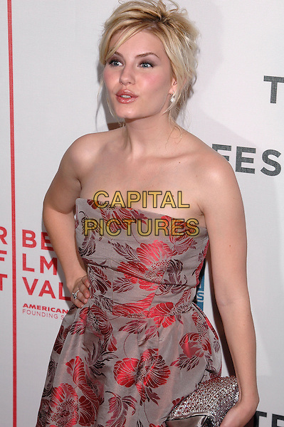 "ELISHA CUTHBERT.Premiere of his new film, ""House of Wax"", at the Stuyvesant High School,  part of the Tribeca Film Festival in downtown Manhattan. .April 30th, 2005.Photo Credit: Patti Ouderkirk/AdMedia.half length strapless red floral print dress  jewel encrusted clutch purse hand on hip.www.capitalpictures.com.sales@capitalpictures.com.© Capital Pictures."