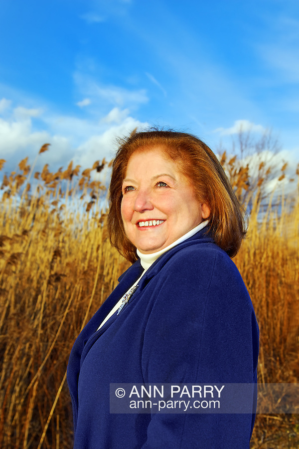 Woman in marshland reeds at Levy Park in Merrick, Long Island, New York, USA