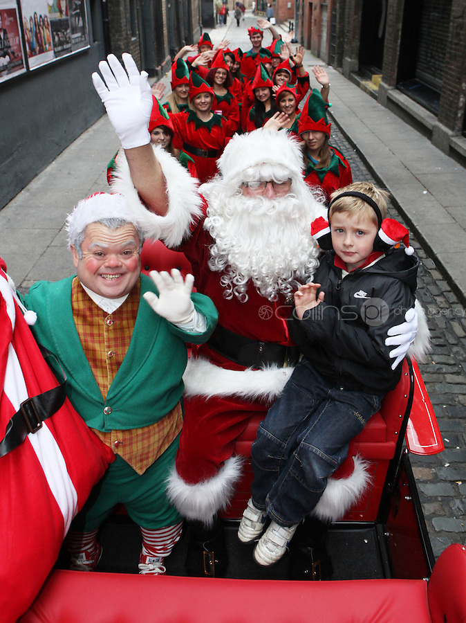 ****NO FEE PIC ******.19/11/2011.Bubbles the elf, Santa Claus & Darradh Lacey (7) from Tallaght.at the opening of Santa's Playland in The Ambassador Theatre,Dublin.One of this Christmas' biggest events is coming!  Santa's Playland takes up residence at The Ambassador Theatre in preparation for this year's festive season.  The spectacular event opens on Saturday 19 November and runs until Friday 23 December. Santa's Playland will see children transported to a magical Christmas paradise.On entering Santa's Playland children will be treated to a special Christmas play time.  The Play Area is full of Christmas treats with bouncy castles, slides and Christmas displays..Photo: Gareth Chaney Collins