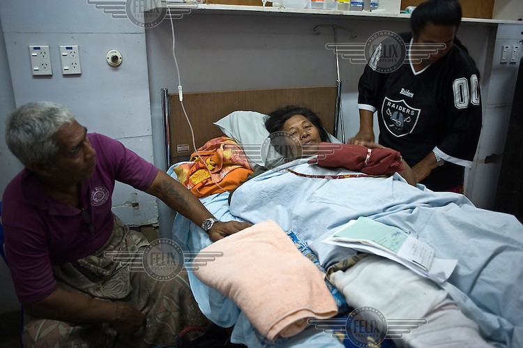 Saipisa Auoai is comforted by friends and family as she recovers from a broken leg in Apia hospital. More than 170 people died when a tsunami triggered by an 8.3 magnitude earthquake hit Samoa and neighbouring Pacific islands on 29/09/2009. Samoa (formerly known as Western Samoa)..
