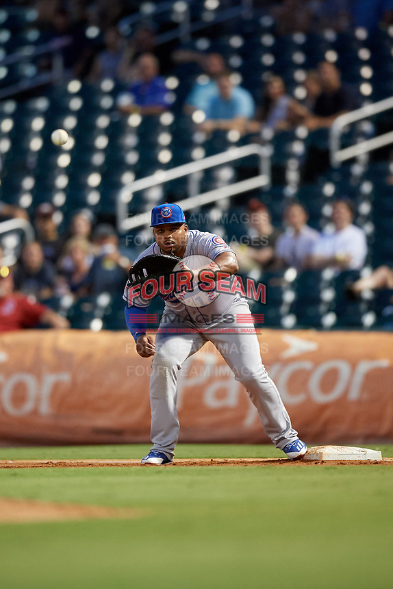 Tennessee Smokies first baseman Yasiel Balaguert (12) waits to receive a throw during a game against the Birmingham Barons on August 16, 2018 at Regions FIeld in Birmingham, Alabama.  Tennessee defeated Birmingham 11-1.  (Mike Janes/Four Seam Images)