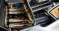 BNPS.co.uk (01202 558833)<br /> Pic: RMSothebys/BNPS<br /> <br /> You do get a gold lined engine bay...<br /> <br /> Sold...for £16.3 million<br /> <br /> Super-rare F1 LM becomes the most expensive McLaren ever sold at auction.<br /> <br /> It is one of just two F1 road cars to be given the Le Mans specification by McLaren, after one won the famous 24hour race in 1995, making it one of the most desirable vehicles in the world.<br /> <br /> You do, however get an engine bay lined with 16g of pure gold (to dissipate the huge heat generated by the 6.1 ltr V12 engine)...and a full set of matching luggage for your money.<br /> <br /> The stunning motor was sold by auctioneers RM Sotheby's at their prestigious Monterey Auction over the weekend.