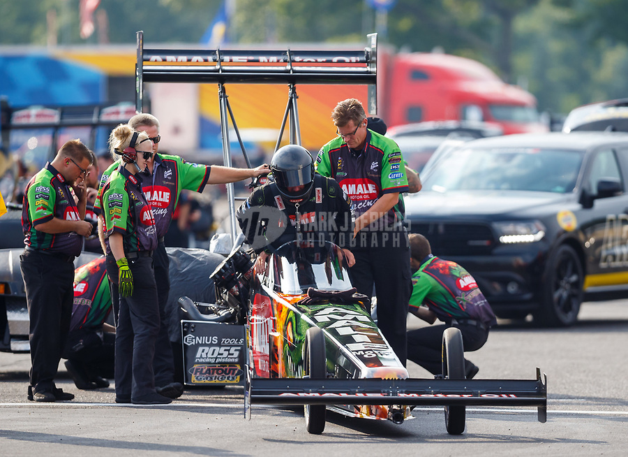 Aug 18, 2017; Brainerd, MN, USA; Crew member with NHRA top fuel driver Terry McMillen during qualifying for the Lucas Oil Nationals at Brainerd International Raceway. Mandatory Credit: Mark J. Rebilas-USA TODAY Sports
