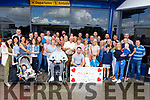 Damien Moynihan and Michelle O'Leary (seated) from Gneeveguilla all ready with their family and friends at Kerry Airport as they depart for Spain for their wedding nuptials on Monday.