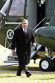 United States President George W. Bush walks away from Marine 1 at the White House in Washington, DC as he returns from Florida on February 13, 2001.<br /> Credit: Ron Sachs / CNP