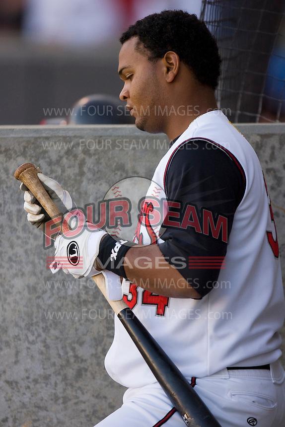 Juan Francisco #34 of the Carolina Mudcats prepares his bat prior to his turn to hit at Five County Stadium May 19, 2009 in Zebulon, North Carolina. (Photo by Brian Westerholt / Four Seam Images)