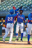 AZL Rangers Keyber Rodriguez (22) is congratulated by Keithron Moss (24) after hitting a home run during an Arizona League game against the AZL Athletics Gold on July 15, 2019 at Hohokam Stadium in Mesa, Arizona. The AZL Athletics Gold defeated the AZL Rangers 9-8 in 11 innings. (Zachary Lucy/Four Seam Images)