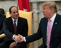 United States President Donald J. Trump shakes hands with President Abdel-Fattah el-Sisi of the Arab Republic of Egypt in the Oval Office of the White House in Washington, DC on April 9, 2019.<br /> CAP/MPI/RS<br /> &copy;RS/MPI/Capital Pictures