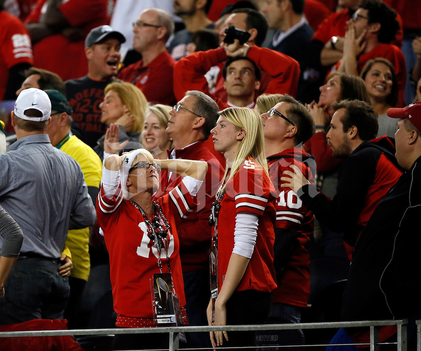 Ohio State fans react to a fumble by Ohio State Buckeyes wide receiver Corey Smith (84) during the second quarter of the College Football Playoff National Championship at AT&T Stadium in Arlington, Texas on Jan. 12, 2015. (Adam Cairns / The Columbus Dispatch)