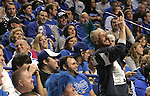 Rick Daily cheers for the Cats during the first period of the Blue and White scrimmage at Rupp Arena Wednesday night..Photo by Zach Brake | Staff