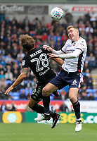 Bolton Wanderers' Josh Vela competing with Leeds United's Gaetano Berardi in the air<br /> <br /> Photographer Andrew Kearns/CameraSport<br /> <br /> The EFL Sky Bet Championship - Bolton Wanderers v Leeds United - Sunday 6th August 2017 - Macron Stadium - Bolton<br /> <br /> World Copyright &copy; 2017 CameraSport. All rights reserved. 43 Linden Ave. Countesthorpe. Leicester. England. LE8 5PG - Tel: +44 (0) 116 277 4147 - admin@camerasport.com - www.camerasport.com
