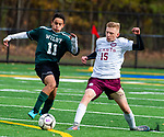 WATERBURY,  CT-101619JS16-  Wilby's Nilton Miguel (11) and Sacred Heart's Aidan Knappe (15) race to a loose ball during their NVL game Thursday at Municipal Stadium in Waterbury. <br />  Jim Shannon Republican-American