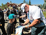 Sebastian Janikowski signs autographs before a practice round at the American Century Championship golf tournament at Edgewood Tahoe at Stateline, Nev., on Wednesday, July 18, 2012..Photo by Cathleen Allison