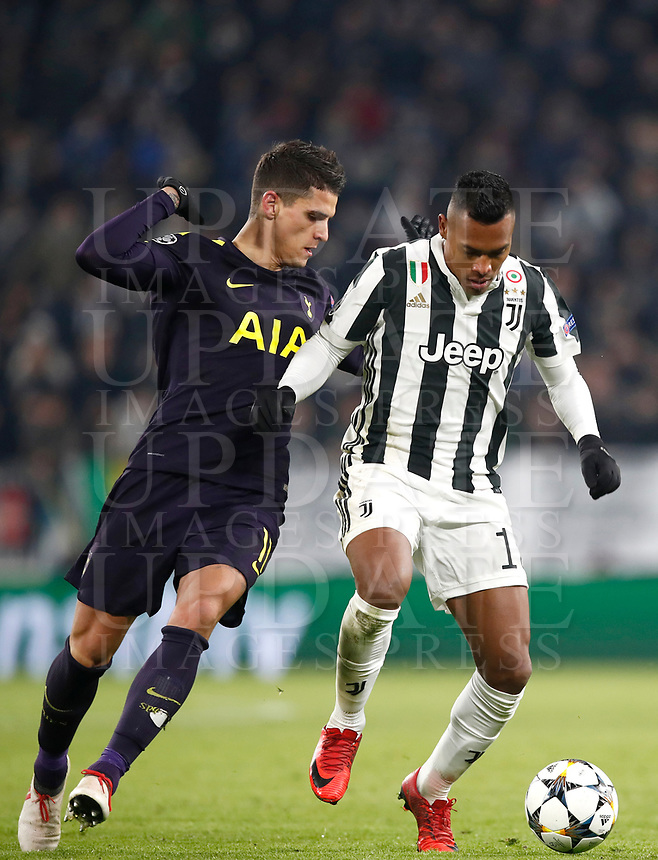 Football Soccer: UEFA Champions League Juventus vs Tottenahm Hotspurs FC Round of 16 1st leg, Allianz Stadium. Turin, Italy, February 13, 2018. <br /> Juventus' Alex Sandro (r) in action with Tottenham's Erik Lamela (l) during the Uefa Champions League football soccer match between Juventus and Tottenahm Hotspurs FC at Allianz Stadium in Turin, February 13, 2018.<br /> UPDATE IMAGES PRESS/Isabella Bonotto
