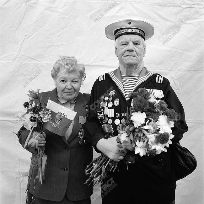 WWII veterans during Victory Day celebrations, left to right - Raisa Alexandrovna Ivanova, b. 1924, Signaller, Anti-Aircraft Defense and Vladimir Semyonovich Semyonov, b. 1921, Marine, Norther, Pacific and Black Sea Fleets. Moscow, Russia, May 9, 2006