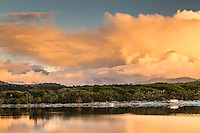 Sunset over Five MIle Lagoon near Okarito with Franz Josef Glacier visible on left under clouds, Westland National Park, West Coast, World Heritage Area, New Zealand