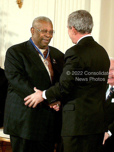 Washington, D.C. - December 15, 2006 -- Riley &quot;B.B.&quot; King  receives the Presidential Medal of Freedom  from United States President George W. Bush and first lady Laura Bush during a ceremony in the East Room of the White House on Friday, December 15, 2006.  The medal is the nation's highest civil award.  It may be awarded &quot;to any person who has made an especially meritorious contribution to (1) the security or national interests of the United States, or, (2) world peace, or (3) cultural or other significant public or private endeavors&quot;.  One of the greatest blues singers and guitarists of all time, B.B. King is an American treasure.  For more than half a century, the &ldquo;King of the Blues&rdquo; and his guitar &ldquo;Lucille&rdquo; have thrilled audiences, influenced generations of guitarists, and helped give the blues its special place in the American musical tradition.  Raised in the Mississippi Delta, he began his career playing on street corners, and today has performed more than 10,000 shows, won 14 Grammys, and been inducted into the Rock and Roll Hall of Fame.  The United States honors B.B. King for his lifetime of achievement as one of America&rsquo;s greatest musicians.<br /> Credit: Ron Sachs / CNP