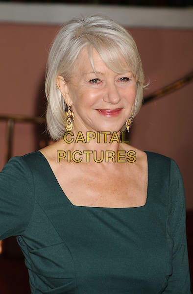 DAME HELEN MIRREN .arriving at The Hollywood Reporter's Power 100: Women In Entertainment Breakfast at Beverly Hills Hotel in Beverly Hills, California, USA, .December 7th, 2010..portrait headshot gold earrings make-up lipstick green .CAP/ROT/TM.©TM/RothStock//Capital Pictures