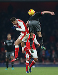 Arsenal's Gabriel gets caught by Southampton's Shane Long during the EFL Cup match at the Emirates Stadium, London. Picture date October 30th, 2016 Pic David Klein/Sportimage
