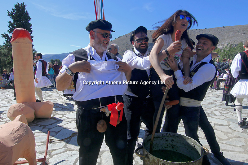 Pictured: A woman is lifted by two men  in Tirnavos, central Greece. Monday 11 March 2019<br /> Re: Bourani (or Burani) the infamous annual carnival which dates to 1898 which takes place on the day of (Clean Monday), the first days of Lent in Tirnavos, central Greece, in which men hold phallus shaped objects as scepters in their hands.