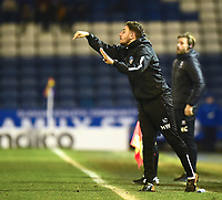 Oldham Athletic's first team coach Max Wragg shouts instructions to his team from the technical area<br /> <br /> Photographer Andrew Vaughan/CameraSport<br /> <br /> The EFL Sky Bet League Two - Oldham Athletic v Lincoln City - Tuesday 27th November 2018 - Boundary Park - Oldham<br /> <br /> World Copyright © 2018 CameraSport. All rights reserved. 43 Linden Ave. Countesthorpe. Leicester. England. LE8 5PG - Tel: +44 (0) 116 277 4147 - admin@camerasport.com - www.camerasport.com