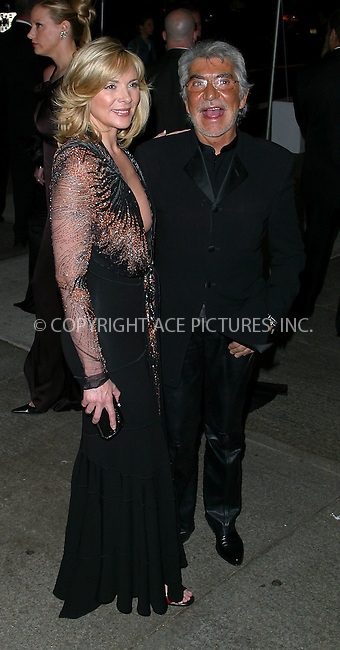 """Kim Cattrall and Roberto Cavalli arrives at the Costume Institute Gala, """"Goddess"""" at Metropolitan Museum of Art in New York. April 28, 2003. Please byline: Alecsey Boldeskul/NY Photo Press.   ..*PAY-PER-USE*      ....NY Photo Press:  ..phone (646) 267-6913;   ..e-mail: info@nyphotopress.com"""