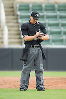 Home plate umpire Derek Gonzalez updates his line-up card during the game between the West Virginia Power and the Kannapolis Intimidators at CMC-Northeast Stadium on April 30, 2014 in Kannapolis, North Carolina.  The Intimidators defeated the Power 2-1 in game one of a double-header.  (Brian Westerholt/Four Seam Images)