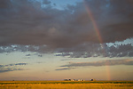 Morning rainbow, clouds, farm on the Great Plains of Colorado