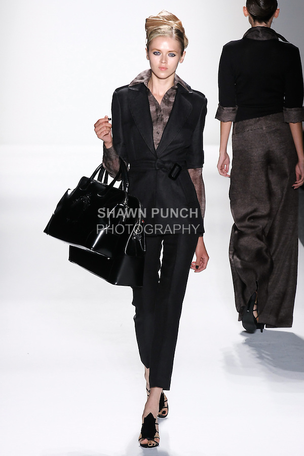 Model walks runway an EBONY LORO PIANA LNEN& WOOL TRENCH JACKET.W/ ATTACHED SILK CAM LINEN WRT + DESERT HAND TOP STITICHNG EBONY LORO PIANA LINEN & WOOL SKINNYPANTS W/ DESERT HAND TOP STITCHING by Zang Toi, for the Zang Toi Spring 2012 My Dream Of North Africa Collection, during Mercedes-Benz Fashion Week Spring 2012.