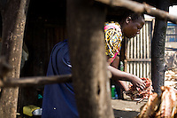 """Jane, a  former sex worker gave up prostitution and  runs a small fish stand in Homa Bay, Kenya. .In her words:.""""When I started in this business of fish, there were so many of us. Competition was strong. Getting fish to sell was a problem. There were men admiring us and ready to sleep with you in broad daylight. There were women going along and they bought fish very easily. My husband was still alive and had no job. We had children. So it forced me to compromise for the daily bread...""""If I look for the lives of my colleagues at that time, I cant see them. They have all died. When I realized I had the virus, I realized I would die if I continued living that way. With the ARVs, I knew I would live longer and it gave me a moment to plan. My husband was dead and I was alone. I needed to respect my children. I had to plan how I was going to live...""""People understand things differently, they perceive things differently. I understood my life differently than others and decided to live it in my own way...""""What I am trying to say to whoever will listen is that you must think strategically, especially if you are HIV positive. You have to think, 'Take care and not poison other people'. There is no reason to die early. Life is how you take it...""""Treatment has changed my life and replaced despair with hope."""""""