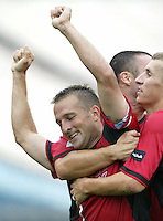26 June 2004:  Dallas Burn Forward Jason Kreis celebrates with team after scoring opening game goal against DC United at Cotton Bowl in Dallas, Texas.  DC United and Dallas Burn are tied 1-1 after the game.   Credit: Michael Pimentel / ISI
