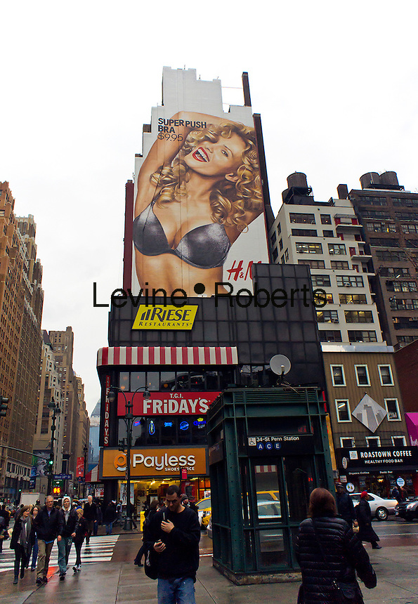 "A billboard for H&M's ""super push bra"" in the Herald Square shopping district in New York is seen on Wednesday, December 21, 2011.  (© Richard B. Levine)"