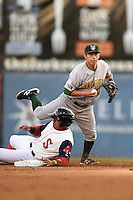 Lynchburg Hillcats shortstop Daniel Castro (12) checks the runner after forcing out Ryan Dent sliding in during a game against the Salem Red Sox on April 25, 2014 at Lewisgale Field in Salem, Virginia.  Salem defeated Lynchburg 10-0.  (Mike Janes/Four Seam Images)