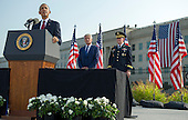 United States President Barack Obama delivers remarks alongside Secretary of Defense Chuck Hagel and Chairman of the Joint Chiefs of Staff General Martin Dempsey during a remembrance ceremony for the 12th anniversary of the 9/11 terrorist attacks, at the Pentagon on September 11, 2013 in Arlington, Virginia. <br /> Credit: Kevin Dietsch / Pool via CNP