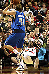 04/03/11--Blazers' Gerald Wallace takes a charge and was called for a foul against Mavericks' Dirk Nowitzki in the second half at the Rose Garden in Portland, Or.. Portland defeated Dallas 104-96.Photo by Jaime Valdez........................................