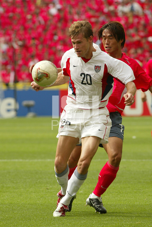Brian McBride traps the ball. The USA tied South Korea, 1-1, during the FIFA World Cup 2002 in Daegu, Korea.