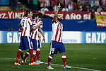 Atletico de Madrid´s players celebrate Arda Turan´s goal during Champions League soccer match between Atletico de Madrid and Juventus at Vicente Calderon stadium in Madrid, Spain. October 01, 2014. (ALTERPHOTOS/Victor Blanco)