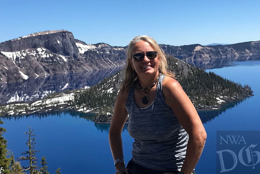 Courtesy photo<br />Deb Walter, a teacher at Rogers New Technology High School, spent the summer exploring out West on a budget of $1,200. She lived out of her car with her kayak and mountain bike traveling wherever her whims took her.