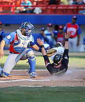 Jackson Melian / Venezuela slides home safely around a tag by Dominican Republic catcher Ronny Paulino on Day 4 - 2009 Caribbean Series, Mexicali..Photo by:  Bill Mitchell/Four Seam Images