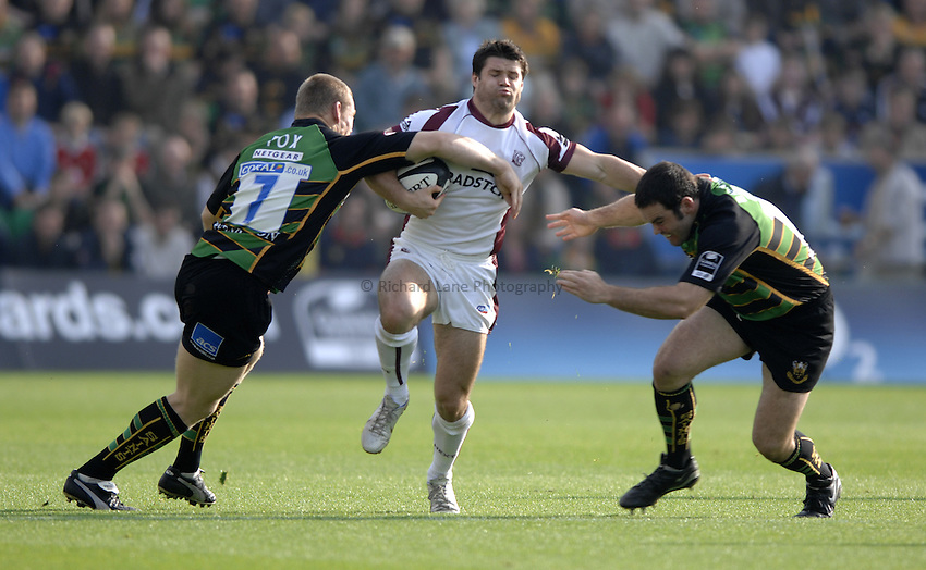 Photo: Richard Lane..Northampton Saints v Leicester Tigers. Guinness Premiership. 14/10/2006. .Tigers' Dan Hipkiss attacks as Darren Fox and Pat Barnard tackle.