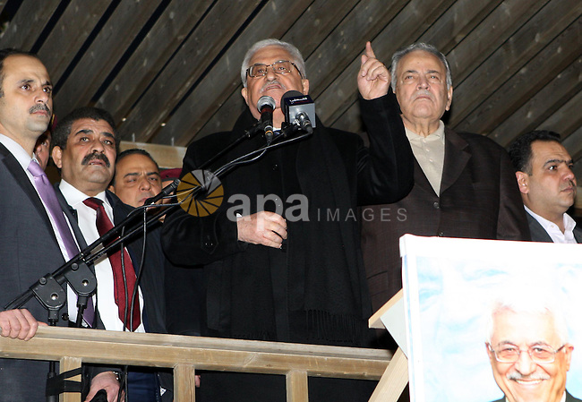 Palestinian President Mahmud Abbas speaks as thousands of Palestinians look on, on the eve of the 48th anniversary of the formation on the Fatah movement, on December 31, 2012, in the West Bank city of Ramallah. The Fatah anniversary commemorates the first operation against Israel claimed by its armed wing then known as Al-Assifa (The Thunderstorm in Arabic) on January 1, 1965. Photo by Thaer Ganaim