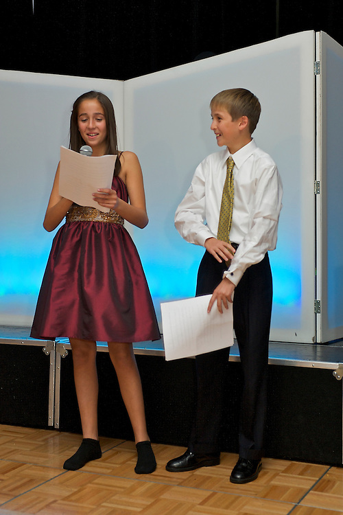Sister and brother making their speeches at a B'Nai Mitzvah party.