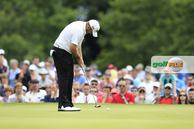 Shane Lowry (IRL) putts on the 9th green during Friday's Round 2 of the 2014 Irish Open held at Fota Island Resort, Cork, Ireland. 20th June 2014.<br /> Picture: Eoin Clarke www.golffile.ie