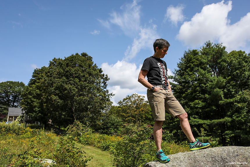 Hiker Beth Zimmer, 61, standing on a boulder in her backyard at home in Meredith, NH, Friday, Aug. 25, 2017.    Beth Zimmer, is just a few hikes from finishing her attempt to redline the AMC White Mountain guide.  CREDIT: Cheryl Senter for The Boston Globe