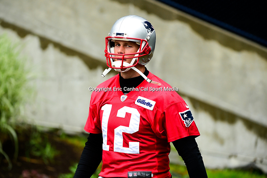 June 6, 2017: New England Patriots quarterback Tom Brady (12) walks to practice in the rain at the New England Patriots mini camp held on the practice field at Gillette Stadium, in Foxborough, Massachusetts. Eric Canha/CSM
