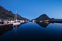 Sailboat mooring at twilight in the harbor at Ramberg, Flakstadøy, Lofoten Islands, Norway