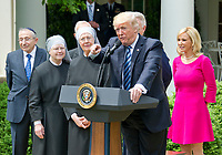 "United States President Donald J. Trump makes remarks prior to signing a Proclamation designating May 4, 2017 as a National Day of Prayer and an Executive Order ""Promoting Free Speech and Religious Liberty"" in the Rose Garden of the White House in Washington, DC on Thursday, May 4, 2017. Photo Credit: Ron Sachs/CNP/AdMedia"